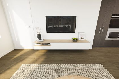 A flat-screen TV sits above a wooden cabinet.