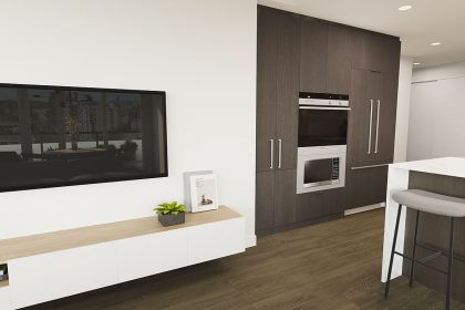 A flat-screen TV sits above some wooden cabinets next to the kitchen space.
