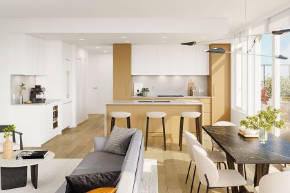 The interior of a NEST residence, featuring the kitchen, dining area, and living area.